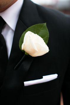 He accessorized with a white pocket square and single rose boutonniere.  Ceremony Venue: Saint Agnes Parish  Reception Venue:InterContinental Boston  Groom and Groomsmen Attire:Russo Tux, Dresses & Limousine  Floral...
