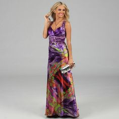 @Overstock - This gorgeous dress from NV Couture features an allover colorful exterior that is highlighted with a stunning beaded neckline and waist. A slight fishtail back with a secure zipper closure finish the look of this beautiful dress.http://www.overstock.com/Clothing-Shoes/NV-Couture-Womens-Multicolored-Criss-cross-Beaded-Halter-Dress/7684934/product.html?CID=214117 $96.99