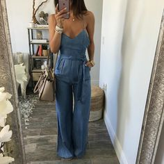 Look long and lean. and chic in this denim wide leg romper! Criss cross back and zipper closure along back. Model is wearing Small and she's Chic Outfits, Summer Outfits, Fashion Outfits, Chambray Jumpsuit, Jeans Jumpsuit, Dress Up Jeans, Jumpsuit Outfit, Wide Leg Denim, What To Wear