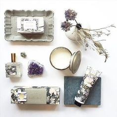 We can't get enough of our favorite sent... Tonka Noir by @illumecandles.  #TreatYoSelf #SundayFunday #Candles #Lotion #Soap #Perfume #Illume #PrettyThings #Beauty #Geostones #FlatLay #Flowers #Purple #Lavender #Gray #VerbenaGirl #ShopLocal