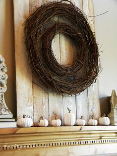 """A Neutral Fall Mantel... I like the idea of putting an old looking """"door"""" on the mantle to add dimension ."""