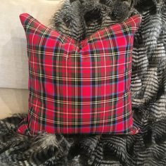 This jewel toned tartan pillow cover is a gorgeous, new take on the classic Christmas plaid. Cherry red and blue bring this beauty to life, accentuated by green, black, white, and yellow secondary tones. Our signature chunky gold zipper, the design detail that brings it all together. Specifications: - 20 x 20 - Cotton/polyester blend - Made to order - Pillow insert not included - Spot clean as needed, dry clean recommended  Complementary Products: 1) Tartan Plaid Tablecloth (Cherry Red)…
