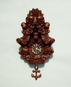 Faethm Cuckoo Clock nautical art wall clock sculpture time decor in chocolate by Marisol Spoon.