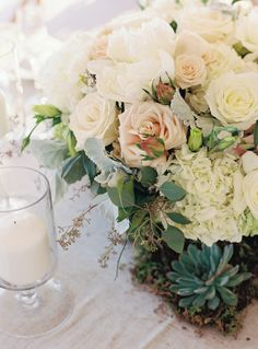 Rose, hydrangea and succulent wedding flowers: http://www.stylemepretty.com/new-york-weddings/rye-new-york/2017/03/16/a-romantic-seaside-wedding-for-university-sweethearts/ Photography: Charlotte Jenks Lewis - http://www.charlottejenkslewis.com/