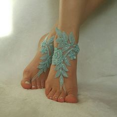 Something blue. A delicate foot accessory to go barefoot at your beach wedding via Etsy.
