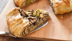 A vegetable tart with robust-tasting filling featuring the classic combination of meaty mushrooms and sweet leeks partially wrapped in a hearty pastry.