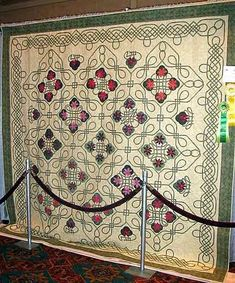 Floral Celtic by Donna E. Johnson. This is the most. Beautiful quilt I've seen. Way beyond my skill level, but one can dream :-)