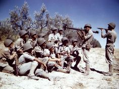Brazilian soldiers, now in training in Italy, are being instructed on the Bazooka by American soldiers.
