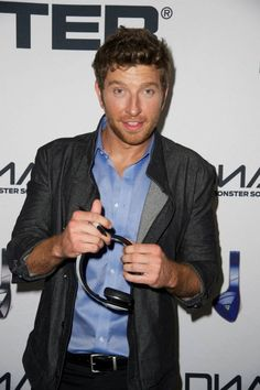 Brett Eldredge signs headphones for charity backstage at the Monster Listening Lounge at the CMT Music Awards. — at Bridgestone Arena.