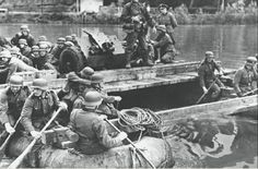 Assault engineers and artillery of the SS-Totenkopf-Division crossing La Bassée canal, 23 May 1940. Camouflage clothing had not been widely distributed to SS-T troops at this early stage in the war, and field-grey army pattern tunics with matching death's head collar patches were the order of the day
