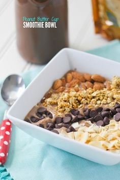 A Peanut Butter Cup Smoothie Bowl from @cookbookqueen is the perfect quick breakfast to get you through the day. It's got rich chocolate peanut butter flavor topped with your favorite additions —  granola, chocolate chips, almonds or coconut chips!