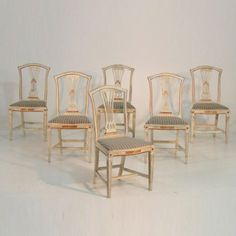 Six Gustavian style chairs, cleaned down to original paint, and gilt, circa 100 years old.