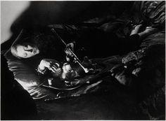 Woman Smoking Opium by Brassaï 1931
