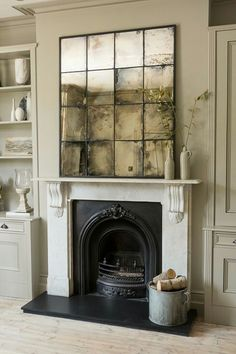 - Mirror Designs - Highly distressed antiqued mirror glass window mirror www. Highly distressed antiqued mirror glass window mirror www. Décor Antique, Antique Decor, Antique Interior, Antique Glass, Antique Jewelry, Antique Mirror Tiles, Antiqued Mirror, Mirror Over Fireplace, Brick Fireplace