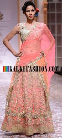 http://www.kalkifashion.com/designers/falguni-shane-peacock-s.html Models wearing Falguni and Shane Peacock collection at Indian Bridal Week Nov 2013 at Mumbai