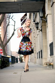 "<p>The NEW Elaine Dress has been hand crafted with love to ensure the beautiful floral design you see here!</p> <p> </p> <p><a title=""Rachel Jensen of Chicago Chic in the Elain Dress, Eden Floral Print"" href=""http://www.chicagochicblog.blogspot.com/2015/03/morning-light-floral-mules-french-bows.html"">Check out Chicago Chic's Blog about The Elaine Dress</a></p> $150.00"