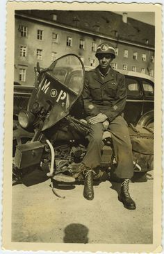 Gaskell Warren posing with his M.P. motorcycle in Munich, Germany in July, 1945. Cookeville History Museum, Volunteer Voices: The Growth of Democracy in Tennessee.
