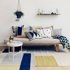Mixing rugs and cushions
