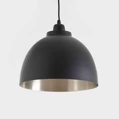 Lovely black and nickel pendant light!This stunning, traditionally styled pendant is made from aluminium and then powder coated matt black, with an antique brushed nickel finish on the inside for a nice soft glow. It looks great lit or unlit. It comes with approximately 100cm of black flex that can be shortened to any length and matching powder coated aluminium ceiling rose. Ideal in kitchens, dining rooms, hallways or living rooms, they look great on their own and also in 2s or 3s. Takes a…
