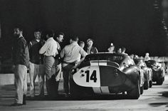 After the 1965 12 Hours of Sebring is over, the Shelby Daytona Coupes are lined up in the pits. The Daytonas dominated the GT classes.