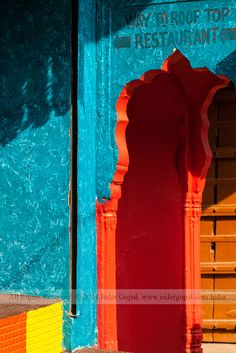 Pushkar Mela - Colourful paints on arcade of a building
