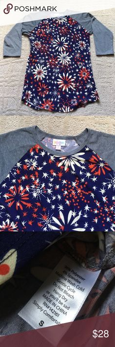 """LuLaRoe fireworks Randy Dark heathered gray sleeves and navy, cream and red firework design! Perfect for any patriotic occasion! All American! Size small, 17.5"""" across chest, long enough to wear with leggings. Tags are NOT connected, but will be included in package. LuLaRoe Tops"""