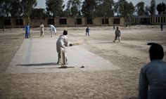 'In Afghanistan, cricket is the second most important thing after peace'  The concrete pitch in Faqrullah's schoolyard, paid for by Guardian readers, is used every break and every day after school in Afghanistan. Photograph: Christoffer Hjalmarsson for the Guardian