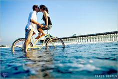 bike in the water? probably not the best idea... but a super cute picture!