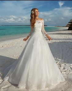 Elegant Long Sleeve A Line Wedding Dresses Appliques Lace Boat Neck Off  Shoulder Organza Bridal Gowns 43d58c421535