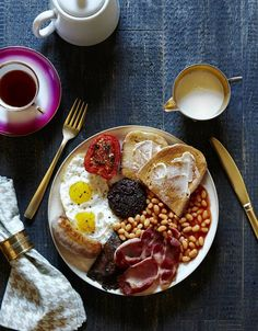 SO VERY BRITISH | The classic combo of sausages, eggs, beans, tomatoes, mushrooms and toast.