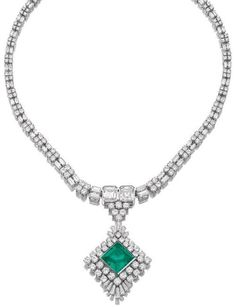 Emerald and diamond pendant necklace.     Designed as a detachable brooch/pendant set at the centre with a step-cut emerald within a border of circular-cut and tapered baguette diamonds, suspended from a necklace set with step-, brilliant-cut and baguette diamonds, length approximately 405mm, brooch fitting.  Sotheby's.