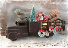 Toy truck with trees and wreaths