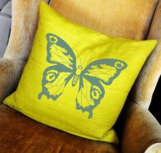 gray and yellow butterfly pillow