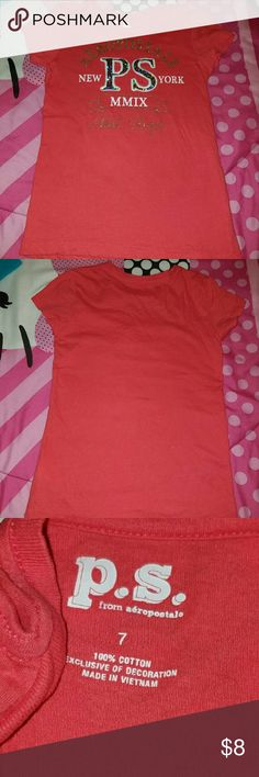 GIRLS SHORT-SLEEVED P.S. AEROPOSTALE SHIRT Girls short sleeve shirt from P.S. Aeropostale  Used and in good condition Peach color with gold/white Aeropostale Shirts & Tops Tees - Short Sleeve