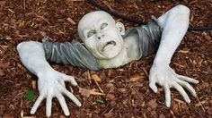 A Nashville, TN, couple may have dug their own graves with their homeowners association by placing a zombie sculpture in their front yard. Zombie News, Yard Maintenance, Landscaping Tips, Holiday Lights, Tennessee, Garden Sculpture, How To Look Better, Landscape, Outdoor Decor