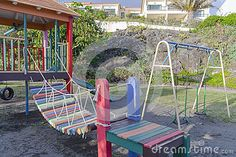 A children's playground in the hotel resort on in Canico de Baixo on Madeira Island in Portugal. Europe.