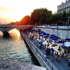 So lovely! Sunset on the Seine for #ParisPlages with some friends #LafargeGroup #Paris #BuildingBetterCities #beach #sand #celebrate #instasunset