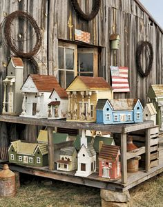 Rick LaChance's remarkable collection of detailed homemade birdhouses sits on display outside his Missouri home.
