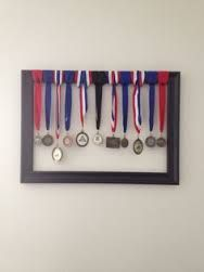 ideas for displaying trophies and medals - Google Search Trophy Display, Award Display, Display Medals, Baseball Bat Display, Trophy Shelf, Medal Displays, Hanging Medals, Trophies And Medals, Displaying Trophies