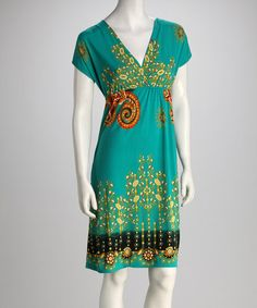 Love the green and orange together! Green Floral Scroll Surplice Dress by jon & anna on #zulily today!