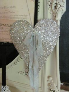glitter heart with pale blue ribbon