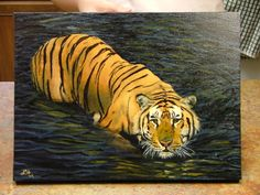 Tiger in Water in oils by Lara Hannam