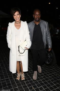 Matching: Perhaps it was deliberate that she was dressed in a similar manner to Kris - who arrived with boyfriend Cory Gamble