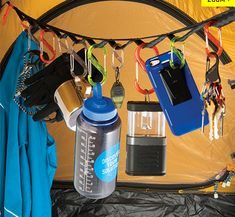 'biners on loops strung across tent. holds everything!