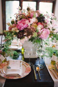 Stunning pink floral arrangement: http://www.stylemepretty.com/south-carolina-weddings/charleston/2014/03/11/tuscan-inspired-shoot-at-magnolia-plantation/ | Photography: Julie Livingston - http://www.julielivingstonphotography.com/