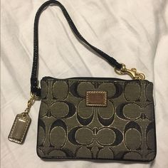 Coach Wristlet Gold and black Coach (poppy) wristlet. Used once. Great condition. Comment with any questions Coach Bags Clutches & Wristlets
