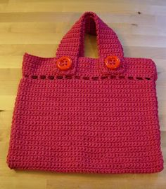 Cute and easy bag.  Uses large buttons.  Could be fun with decorated buttons.