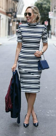 navy and white striped mock neck midi dress, navy double breasted blazer, navy patent pointed toe pumps, navy crossbody bag, aviator sunglasses + low bun hairstyle {finders keepers the label, tommy hilfiger, jimmy choo, phillip lim, ray-ban}