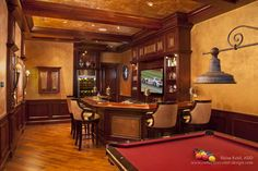 Game Room - Hand punched copper panels with nailhead details set the color scheme for the new Game Room. Leather bar chairs add comfortable seating at the custom designed bar