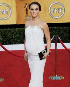 Natalie Portman: Awards season and its endless appearances could pose a problem for some pregnant stars, but Natalie works the red carpet with ease in a white strapless gown. Clean colours and a strapless shape allows your bump to take centre stage.